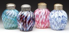 REVERSE SWIRL CASED SPATTER SALT SHAKERS, LOT OF FOUR, ball forms comprising blue and opal, cranberry and opal, green and opal, maroon and opal, period lids including a matching pair. Late 19th/early 20th century.