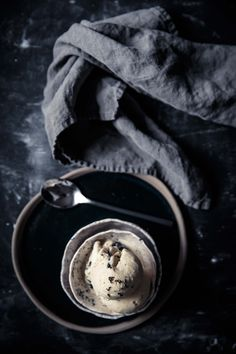 This black truffle ice cream is nothing short of heavenly. A thick and creamy custard based ice cream infused with fresh black truffles and drizzled with dark chocolate. Serve on it's own or with a delicious winter dessert. | Food Photography | Food Styling | Food Props | Anisa Sabet | The Macadames