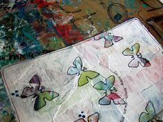 paint with stencils over a collage page