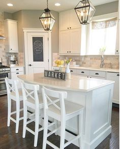 White transitional farmhouse kitchen. With IKEA stools & ceasarstone…