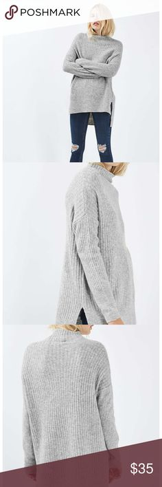 Oversized Long Line Funnel Jumper Boost your knitwear collection with this supersoft mid-weight oversized jumper. Finished with a built-up funnel neckline, it's ideal for cosy layering under a boyfriend coat. 78% Acrylic, 19% Polyester, 3% Elastane. Machine wash.  Colour: GREY  Product Code: 23R02KGYM Topshop Sweaters Cowl & Turtlenecks