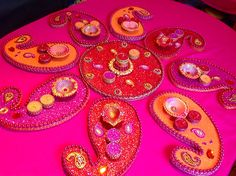 Beautiful hand made mehndi plates in vibrant red,pink and orange. Checkout my Facebook page www.facebook.com/mehnditraysforfun for more ideas and inspiration