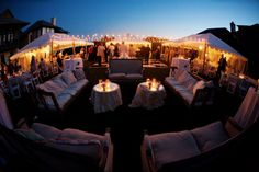 String lights perfectly connects the tents and provides overhead lighting for the dance floor.