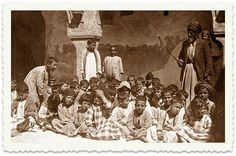 In 1934, the Agency asked Ben-Zion to contact the Israel community in Mosul. In the photo: A classroom for Jewish children with the teacher holding a stick