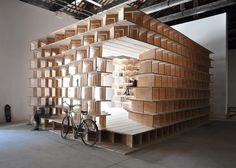 Slovenian architects Aljoša Dekleva and Tina Gregorič have built a wooden library inside their national Biennale pavilion, and invited industry figures including Tatiana Bilbao, Konstantin Grcic and Alice Rawsthorn to fill it with books.