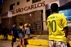 Celebs and fans show their support for Neymar-----Brazil football fan stay outside Sao Carlos Hospital where superstar striker Neymar was treated after being injured during the quarter-final football match between Brazil and Colombia at the Castelao Stadium in Fortaleza during the 2014 FIFA World Cup on July 4, 2014. Brazil star Neymar was ruled out of the World Cup after that with a back injury, team doctor Rodrigo Lasmar said.