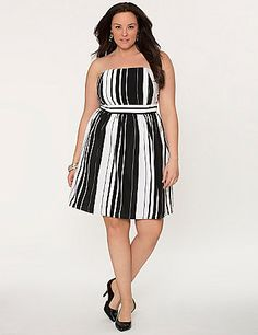 Sexy shoulders steal the spotlight in our silky striped tube dress. Dramatic black & white stripes are having a major moment this season - perfect for day or evening with your favorite accessories. Smocked back and adhesive top provide a secure fit, with hidden side zipper and hook & eye closure.   lanebryant.com