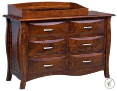 Complete with detachable changing table box and pad, the Amish handcrafted Modelli can be used as a baby changing table then later a bedroom dresser.