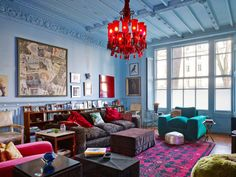 Iamazing home of jewellery designer Solange azagury partridge. red chandelier, powder blue walls and a vintage eclectic mix of furnishings makes this room a take your breath away nest of fubulousness