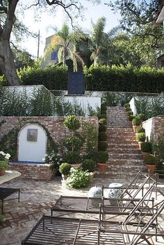 love the potted topiaries lining the stairs