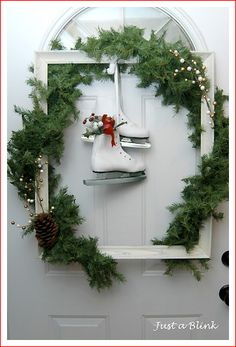 love the frame and out of the box wreath idea!  Would also be cool with old windows with the panes removed...