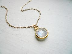 Tiny Moonstone Necklace in Gold - Dainty Everyday Bezel Gemstone and 14K Gold Filled Rainbow Moonstone Necklace by roundabout on Etsy https://www.etsy.com/listing/126623054/tiny-moonstone-necklace-in-gold-dainty