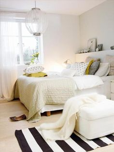 25 gorgeous bedroom decorating ideas - bold stripe rug, pops of yellow and pattern pillows + great mix of fabrications