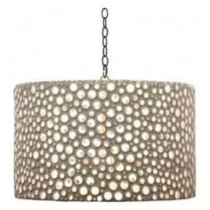 Use an old lampshade and cover with minature mirrors or colored clear stones