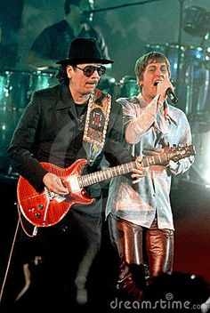 Rob Thomas and Carlos Santana.  This is the song that made me discover Rob and Matchbox Twenty.  (Rob - what is up with those pants?)
