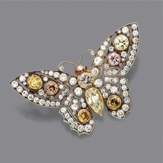 Colored diamond butterfly pin brooch