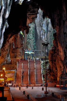 Batu Caves -- Kuala Lumpur ......The caves are 400 million years old, situated in a natural limestone hill. In the 1800s, the caves became a place of worship for the Hindus, with the largest cave being the Temple Cave. It takes a climb of 272 steps to reach the Temple Cave, where the ceiling of the cave is more than 100m above the ground illuminated by sunlight that shines through openings at the top of cave.