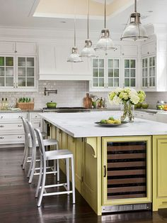Add color to an all-white kitchen with a painted island. More remodeled kitchens: http://www.bhg.com/kitchen/remodeling/makeover/kitchen-remodeling-pictures/?socsrc=bhgpin121212=8