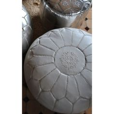 Morrocan Pouffe in white Leather. Loving the mini pouffe in silver leather...
