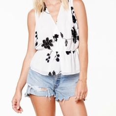 BB Dakota Annie Tank White chiffon material tank with a cross over front. Black embroidered florals. Never worn..with tags. BB Dakota Tops Tank Tops