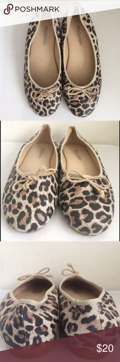 Elephantito Ballerina Learher Leopard w/gross 13 Elephantito Ballerina Leather Leopard w/ gross Smooth leather upper is covered in an allover leopard print. A dainty bow adorns the front. Grosgrain trim. Slip-on design for easy on and off. Smooth breathable leather lining & a cushioned leather insole. Durable rubber outsole. EUC w/ original box Size 13.  Smoke/pet free home. Elephantito Shoes Dress Shoes