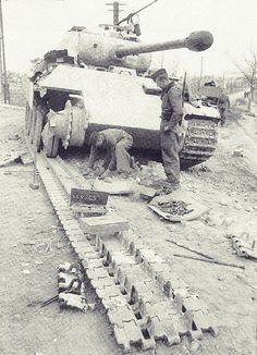 Repairing a blown Panther track. Eastern Front,1944.