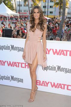 Leggy lady: Brazilian bombshell Izabel Goulart, 32, who plays Amber in Baywatch, opted for a thigh-skimming pink mini dress with cutouts on the side at the premiere in Miami on Saturday