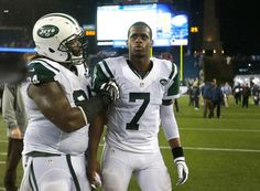 Geno Smith #7 of the New York Jets is consoled by Damon Harrison #94 after a loss to the New England Patriots at Gillette Stadium on Septemb...
