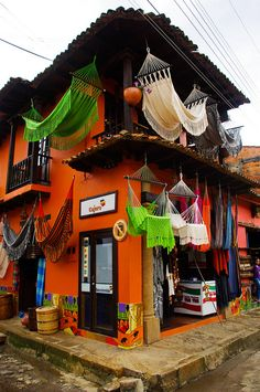 Corner market in Raquira, Boyaca, Colombia by Looks like a dangerous place to put a hammock though Central America, South America, Latin America, The Places Youll Go, Places To See, Beautiful World, Beautiful Places, Ushuaia, Shop Around