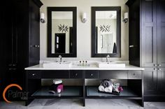 This his and her bathroom could easily fall into the cheesy, kitschy category of styles gone by – but with the addition of modern, black cabinetry, the space takes on a whole new life. It even has a bit of a futuristic feel, don't you think?