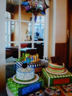 graduation cakes  and cake stands for my three kids graduation party; college, high school and middle school