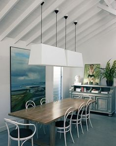 Modern clean dining room, great lighting.