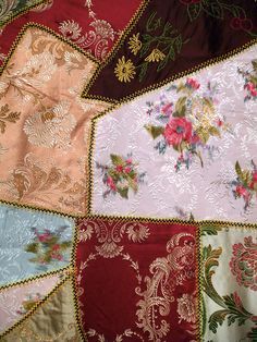 Detail of crazy quilt, ca. 1885-95. KSUM 1994.39.2.  This quilt belonged to Florence Crawford, wife of Colonel George Crawford, Master of the King's Horse at the Belgian court. Col. Crawford worked for the Belgian king for several decades, and was the first person to import the Belgian horse to the United States. This quilt is thought to have been made of scraps of dresses worn for court occasions. (Collection of the Kent State University Museum)