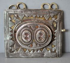 My first Kazakh pendant (fragment of a three part chest ornament) purchased when I was 14 This one I believe is 18th c gilt, silver, glass windows. (private collection Linda Pastorino)