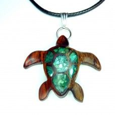 For our partnership with Sea Turtle Conservancy, we have created a special line of handmade turtle-themed items. For every sale of an item from the Sea Turtle collection, 20% will be donated directly to STC.  This sea turtle pendant is handmade from Two-Tone Cocobolo wood. The inlay is blue/green coloured crushed shell. Cocobolo is a tropical hardwood from Central America and has a rich, shiny golden-brown hue when finished. The sapwood is a creamy yellow.