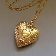 An Exquisite Signed Genuine 10K Solid Gold Antique Locket in a Heart Shape with Ornate Repousse Scrollwork and Flower Engravings, Interior 10K Gold