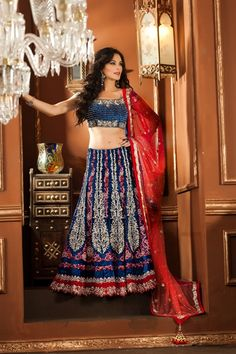 Like it, but wish it had a waist band insted of the kalis going all the way to the waist -- Exclusive blue color lehenga choli in velvet material