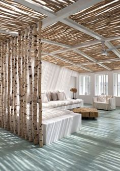 Love the birch tree trunks and the lighter feeling in the room
