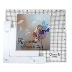 Scor-It - Position-It Position It  Use as a positioner (line images up) Use as a repositioner for perfect coloring or painting! The non-slip, position-it is perfect for card makers and scrapbookers. Includes one 10 by 11-1/2 by 1/8-inch gridded wood board, two wood positioners (7-1/2 by 7-1/2-inch & 5 by 5-inch), no-slip-feet, three acrylic pegs, and complete instructions for use. Simply position and align images, or parts of images and reapply detail.