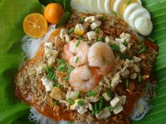 Pancit palabok. A filipino style noodle dish that was influenced by the chinese population living in the philipines.