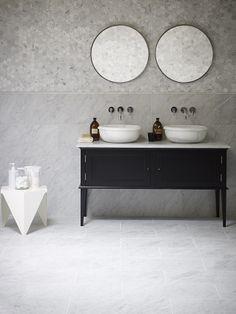 Classic combination. Cararra Honed Marble tiles, Cararra Pencil, and Cararra Hexagon Mosaics with Calacatta Saturn Basins and Chelsea Vanity. All available at Mandarin Stone.