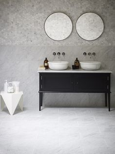 Classic combination. Cararra Honed Marble tiles, Cararra Pencil, and Cararra Hexagon Mosaics with Calacatta Saturn Basins and Chelsea Vanity. All available at Mandarin Stone.