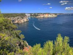 Costal view of Cala galdana #summer2017  #bluesky  #calagaldana #menorca #baleares #trees #clearwater #cliffs  #greatview #picoftheday #iphone7  #holiday