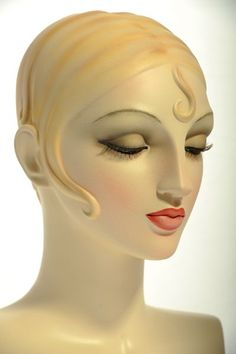 """This is a vintage mannequin head from www.VaudevilleMannequins.com newest (oldest!) collection.  It has the very Art Deco feel of Tamera De Lempicka paintings from the 1920's.  We haven't yet decided on the grouping name, although we're leaning toward """"Tamera""""-do you think anyone will get it?  These heads are available on most poses that we make."""