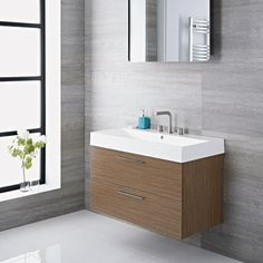 Exceptionally manufactured for everyday use, this stylish wall mounted vanity includes a polymarble basin, and a stunning gray finish sure to suit any modern or traditional bathroom. Grey Vanity Unit, Basin Vanity Unit, Vanity Units, Wall Hung Vanity, Bathroom Storage, Bathroom Ideas, Bathroom Organization, Bathroom Mirrors, Bathroom Cabinets