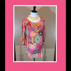 "Stunning tunic top Sunny day colors in this comfortable tunic with elastic neckline and bell sleeves. Measures 25"" from back neck to bottom hem. 95% poly, 5% spandex. Worn twice so in perfect condition. Tops Tunics"