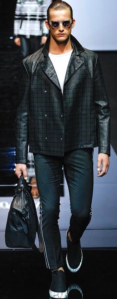 Emporio Armani Spring-Summer Collection 2015. Black  jacket, white t-shirt, trousers. Travel bag.