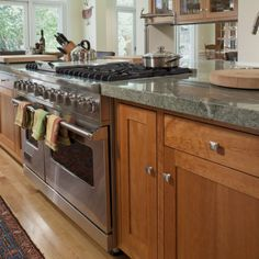 Costa Esmeralda granite with stain grade cabinets. Traditional kitchen by Camber Construction Green Countertops, Kitchen Countertops, Stone Countertops, Granite Kitchen, Wooden Countertops, Kitchen Wood, Kitchen Backsplash, Country Kitchen, Staining Cabinets
