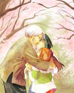 Hayao Miyazaki hugging the characters in his creation Spirited Away.