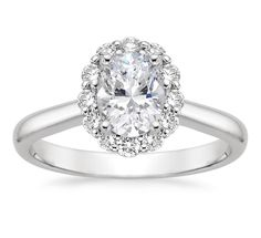 Lotus flower diamond ring with oval! Love that the band is plain and simple. Stunning.